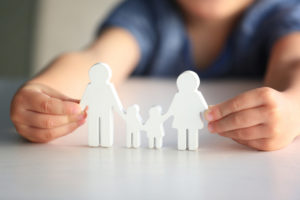 Child holding family cutout